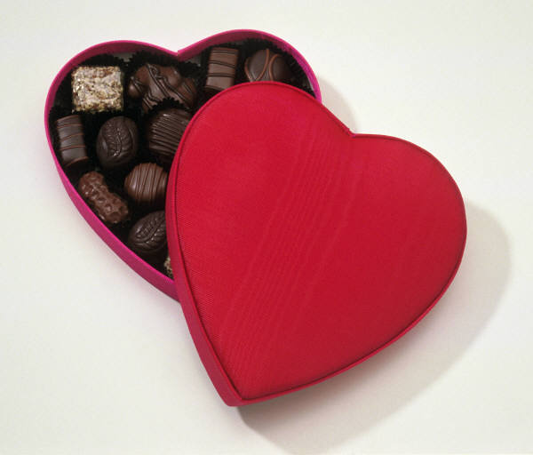 picture of dark chocolates in a red heart container